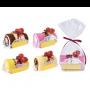 toalla en forma de tronco de pastel en bolsita de regalo