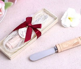 cuchillo untador con mango tapn de vino