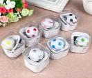 Reproductos mp3 con auriculares en forma de balón de fútbol