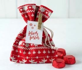Bolsa motivos navideños con bombones y tarjeta de felicitación