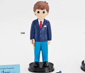 Figura de comunión niño con traje azul y libro en la mano